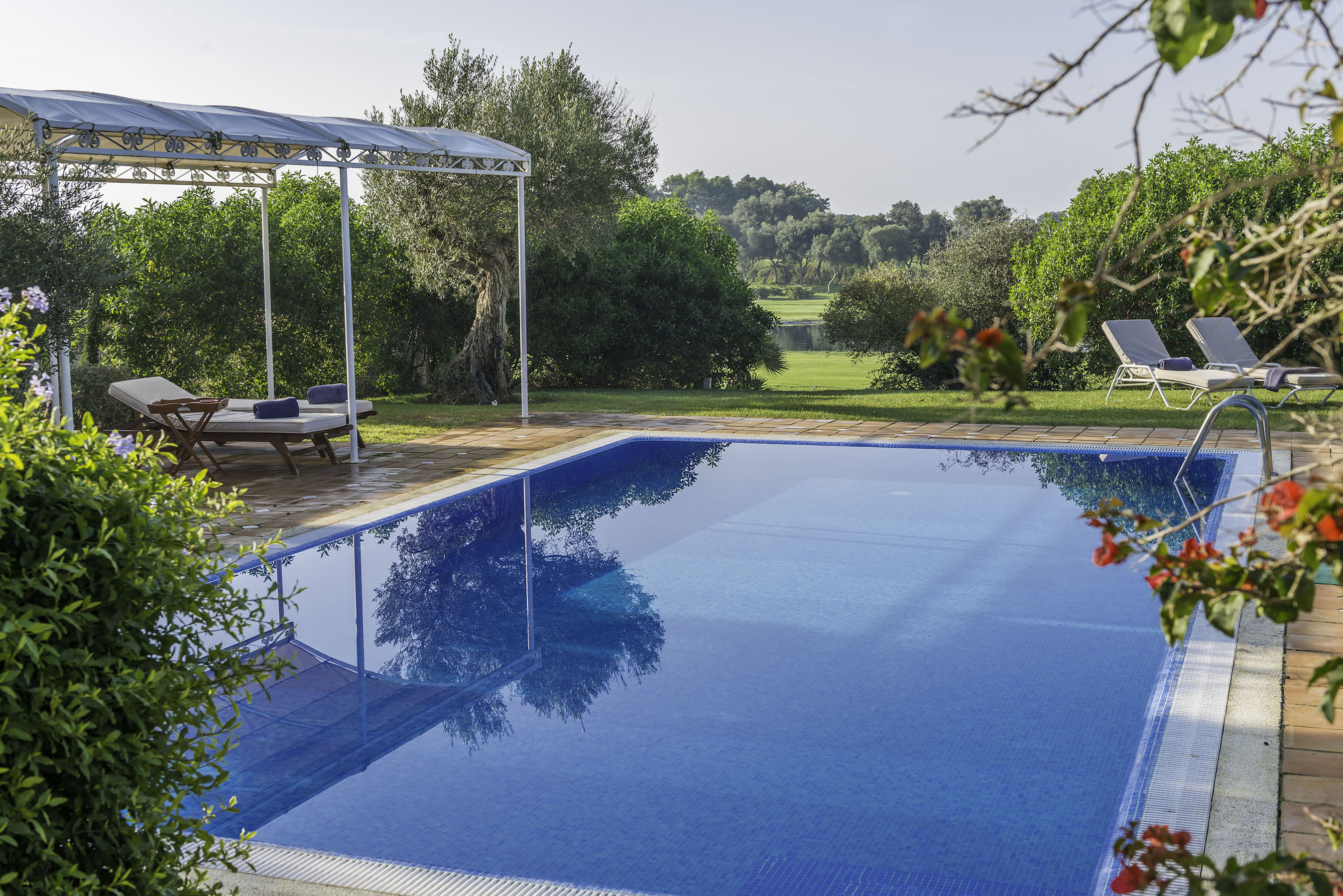 Villa Amapola pool garden and adjoining golf course