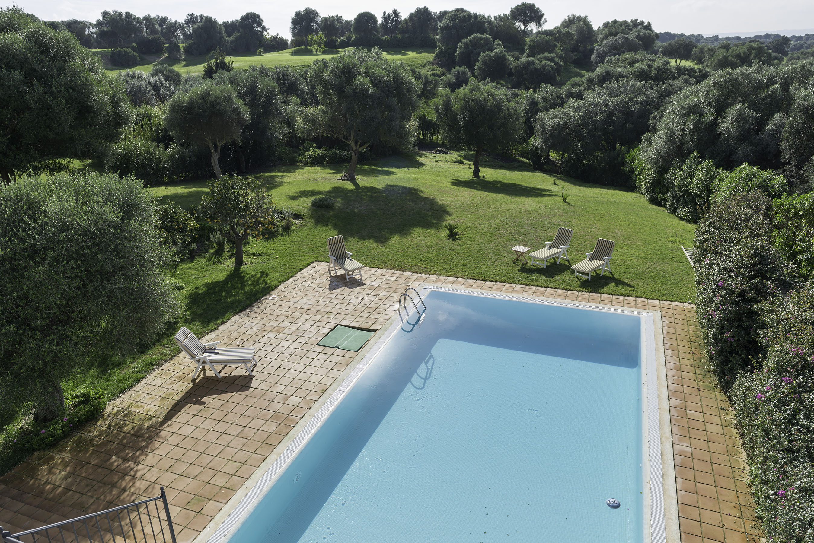 Villa Capuchina pool and garden with adjoining golf course
