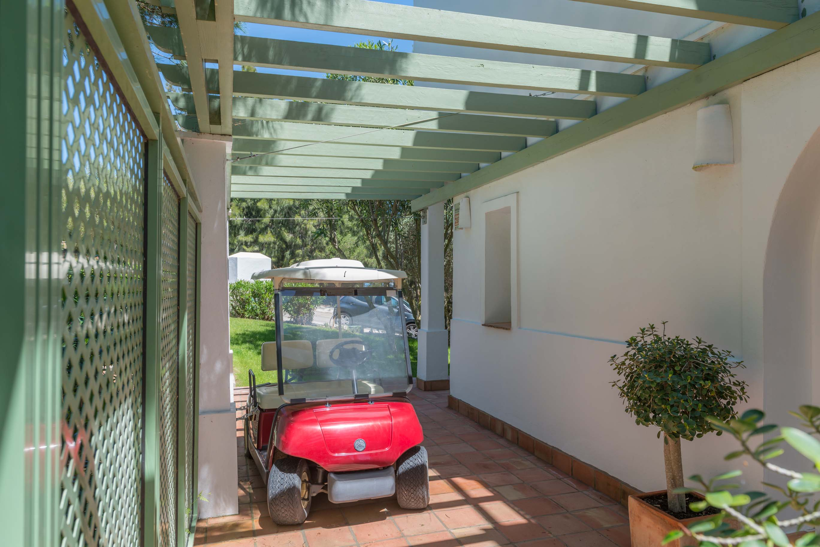 Villa 56-  Pergola on side of house, area perfect to park the buggy